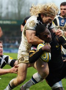 Christian Wade of London Wasps is tackled by Tom Biggs of Bath
