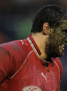 Damien Lagrange of Agen with his face covered in mud