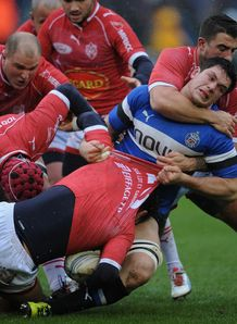 Francois Louw of Bath is tackled by Agen