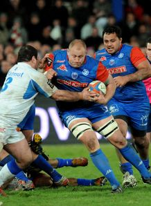 Grenoble s South African lock Naude Beukes vies with Castres defence