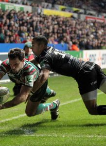 Leicester s Niall Morris beats the tackle of Ospreys Eli Walker