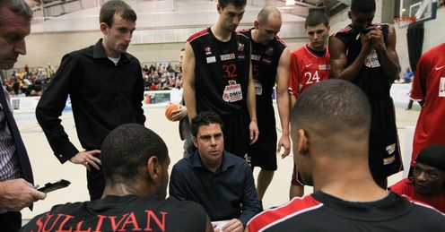 Riders coach Rob Paternostro delivers a team talk to his charges