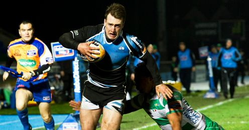 Glasgow Warriors Stuart Hogg speeds past from Loamanu Christian of Treviso