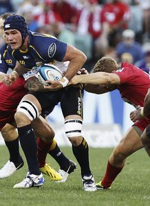 Brumbies captain Ben Mowen held in a tackle