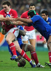 George North of Wales is tackled by Thierry Dusautoir of France