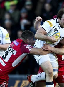 Henry Thomas of Sale is tackled by Paulica Ion of London Welsh