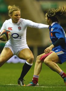 Kay Wilson of England hold off Elodie Guiglion of France during the Women s RBS Six