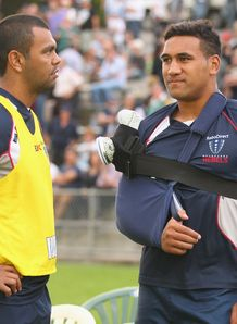 Kurtley Beale standing with Cooper Vuna