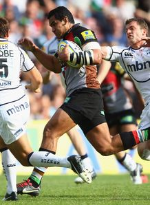 Maurie Fa Asavalu of Harlequins is tackled by Rob Miller and Mark Cueto of Sale