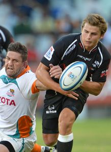 Pat Lambie of the Sharks and Frans Viljoen of the Cheetahs