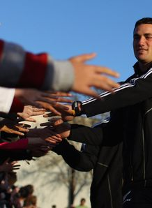 Richard Kahui shaking hands with fans