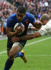 Wesley Fofana of France evades a tackle by Charlie Sharples of England