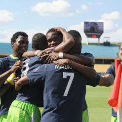 Malokase: Celebrates with team-mates