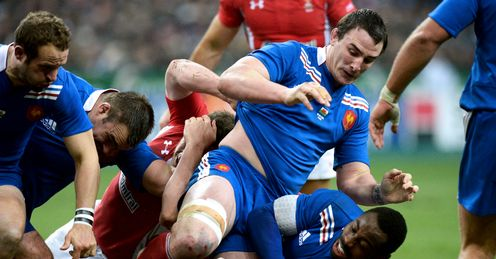 Louis Picamoles and Fulgence Ouedraogo right compete with Mike Phillips floor France v Wales Six Nations Stade de France Paris