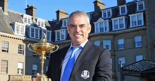 McGinley poses with the Ryder Cup outside the Gleneagles hotel