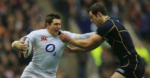 Alex Goode of England hands off Tim Visser of Scotland