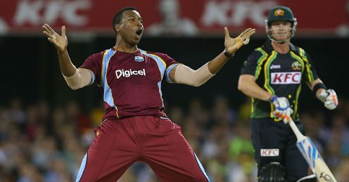 Kieron Pollard of the West Indies celebrates after dismissing Brad Haddin of Australia