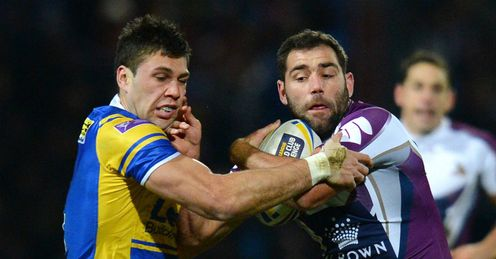 Leeds Rhino s Joel Moon L vies with Melbourne Storm s Cameron Smith