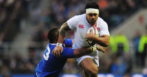 Mathieu Bastareaud of France tackles Manu Tuilagi of England
