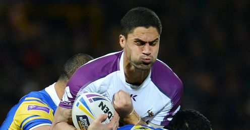 Melbourne Storm s Jesse Bromwich C is tackled by Leeds Rhino s Kylie Leuluai