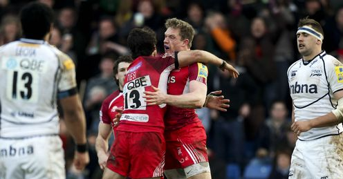 Phil MacKenzie of London Welsh celebrates with team mate Gonzalo Tiesi L after scoring a try