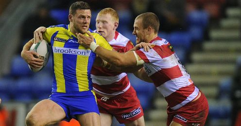 Simon Grix Warrington tackled by Liam Farrell and Lee Mossop of Wigan