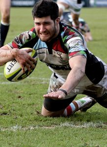 2Centre Tom Casson of Harlequins dives over to score a try during the LV Cup Final