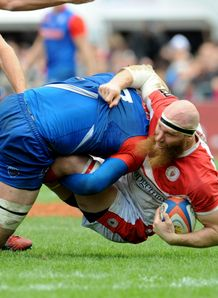 Biarritz s lock Erik Lund R is tackled by Grenoble
