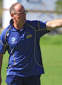 Coach Jake White gives instructions during a Brumbies Super Rugby training session