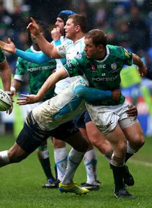 David Paice of London Irish offloads v Worcester