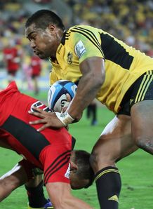 Hurricanes wing Julian Savea bouncing off Israel Dagg