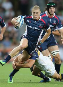 James O Connor slipping a tackle for Rebels