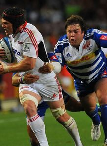 Matt Todd of the Crusaders is tackled by Frans Malherbe of the Stormers