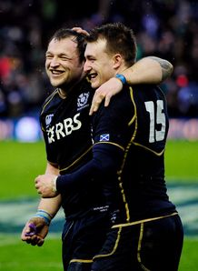 Scotland duo Geoff Cross celebrating with Stuart Hogg