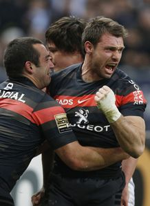 Toulouse s winger Vincent Clerc R reacts after scoring a try