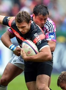Toulouse s winger Vincent Clerc vies with Stade Francais