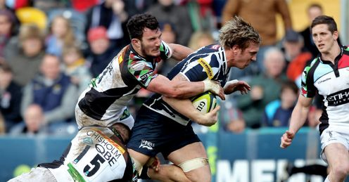 Andy Powell of Sale Sharks is hauled down by Ross Chisholm and George Lowe of Harlequins
