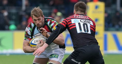 Chris Robshaw of Harlequins takes on Owen Farrell