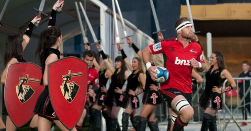 Crusaders captain Kieran Read R leads his team onto the field