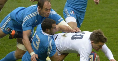 England s fly half Toby Flood R is brought down by Italy s centre Gonzalo Canale C