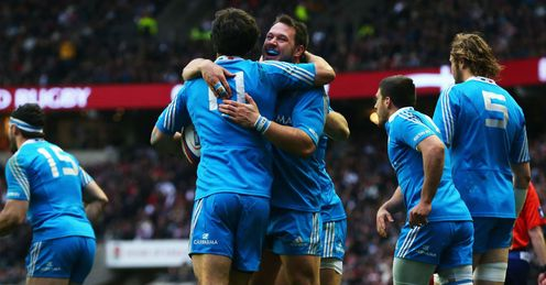 Luke McLean of Italy celebrates scoring their first try with Alberto De Marchi