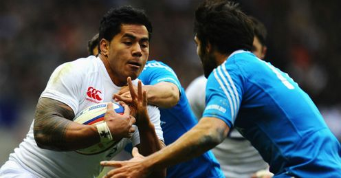 Luke McLean of Italy tackles Manu Tuilagi of England