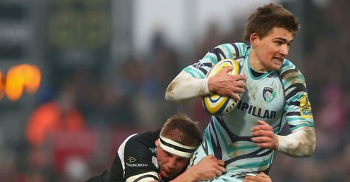 Toby Flood R of Leicester Tigers is tackled by Carl Rimmer of Exeter Chiefs