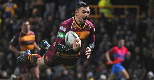 Danny Brough Huddersfield Giants diving over for a try against Leeds Rhinos