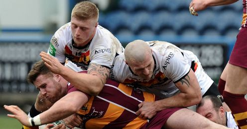 Anthony Mullally Huddersfield Giants tackled by three Bradford players