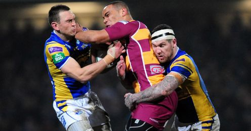 Leory Cudjoe Huddersfield Giantsrunning with the ball against Leeds Rhinos