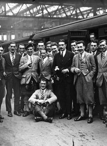 1924 - The British Rugby team on the platform at Waterloo ahead of their tour to South Africa. Centre is the captain Ronald Cove Smith with their mascot Felix