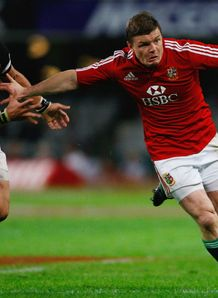 2009 - British and Irish Lions centre Brian ODriscoll holds off a challenge during the match against the Sharks