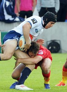 Agen s Romain Edmond Samuel 2nd L is tackled by Perpignan