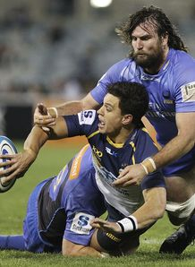 Brumbies ten Matt Toomua tackled by Force lock Toby Lynn